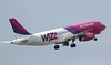 Wizz Air A320 HA-LPL departs. By Jim Calow.
