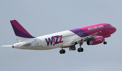 Wizz Air A320 HA-LPL departs. By Jim Calow.