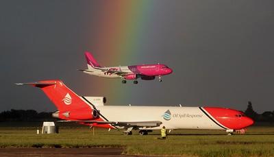 Wizz Air HA-LYK & T2 Aviation 727-200 G-OSRA. By Jim Calow.