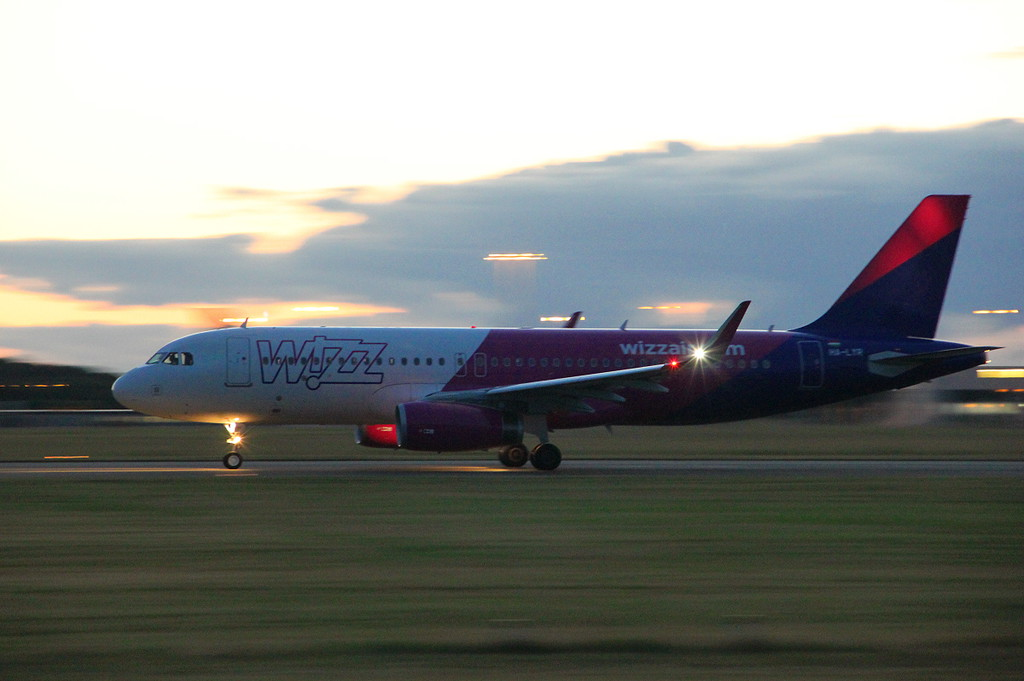Wizz Air A320 HA-LYR departed shortly after 10pm.<br /> By Clive Featherstone.