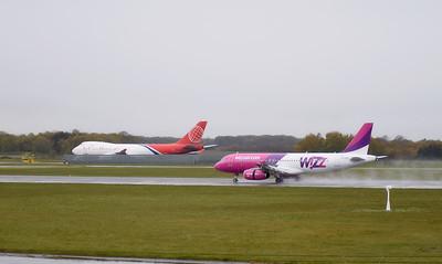 Wizz Air A320 HA-LWP & Air Cargo Global 747-400F OM-ACA. By Callum Devine.