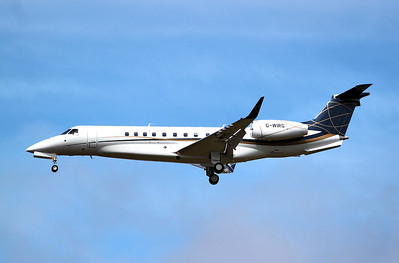 Air Charter Scotland,  EMB-135BJ  Legacy 650, G-WIRG did a few training circuits in the wind. By Graham Miller.