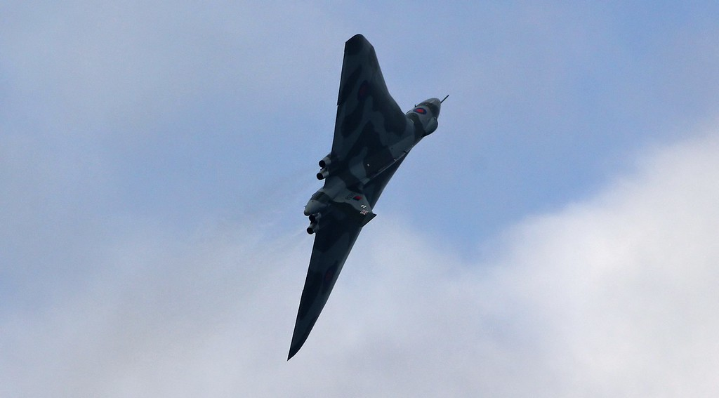 A final wing over off the top of the climb.<br /> By Jim Calow.